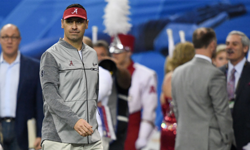 Steve Sarkisian during pre-game warmups
