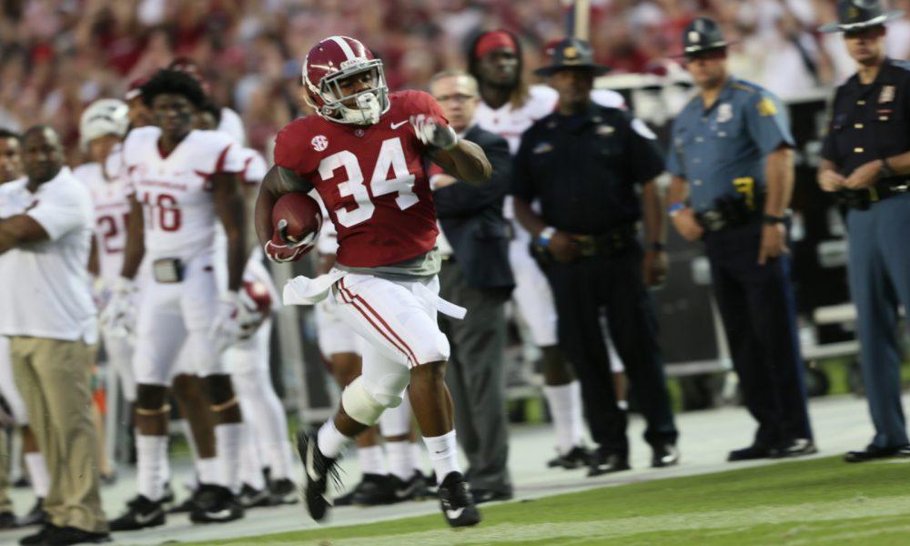 damien harris running for a touchdown