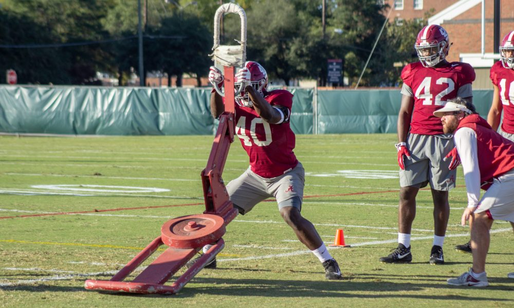 Joshua McMillon working sled at 2018 practice