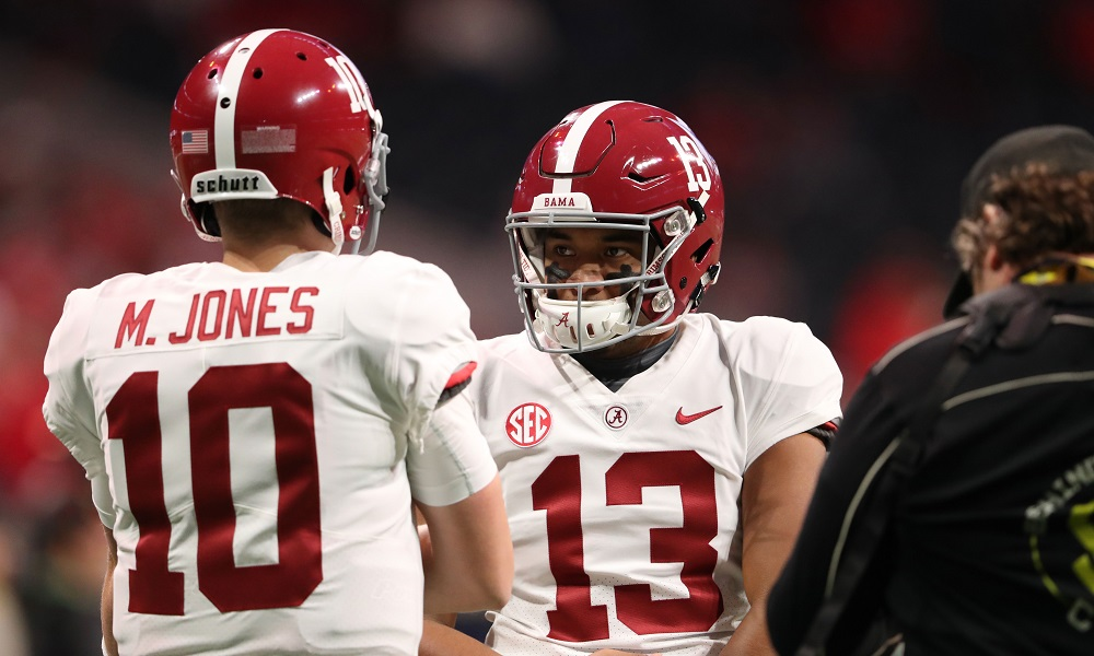 Tua and Mac Jones talking during a game