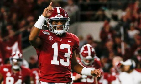 Tua Tagovailoa points one finger to the sky in celebration after scoring drive versus Tennessee in 2019