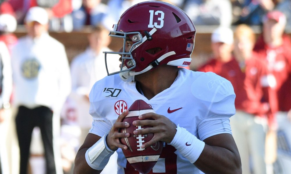 Tua Tagovailoa holding the ball during a matchup versus Miss. State in 2019