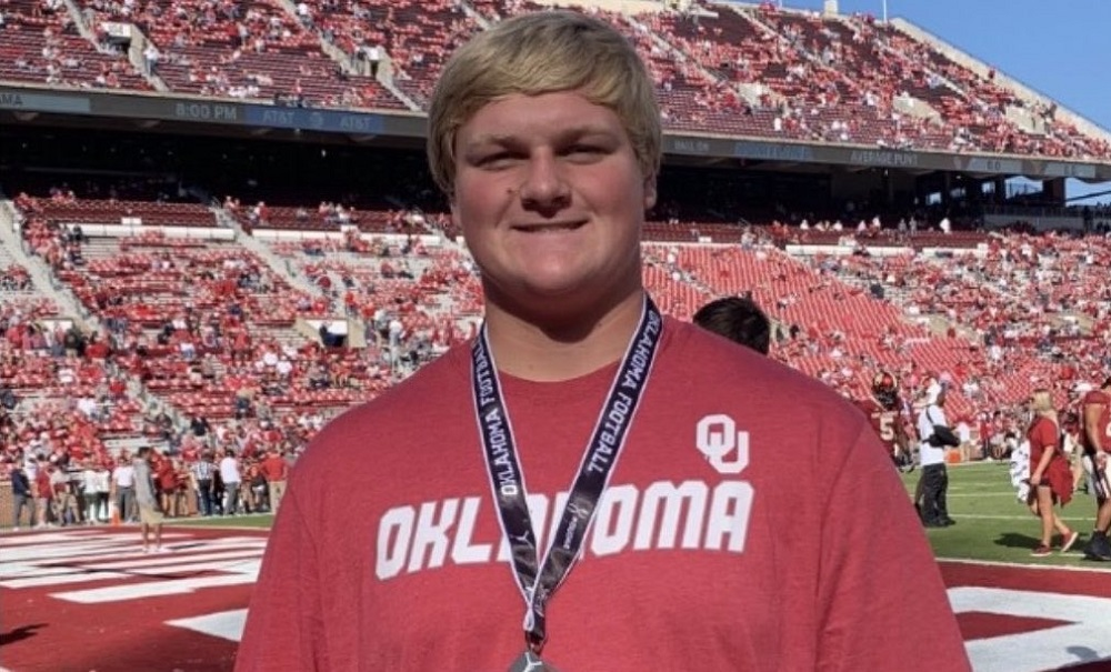 Jacob Sexton poses for picture doing Oklahoma visit