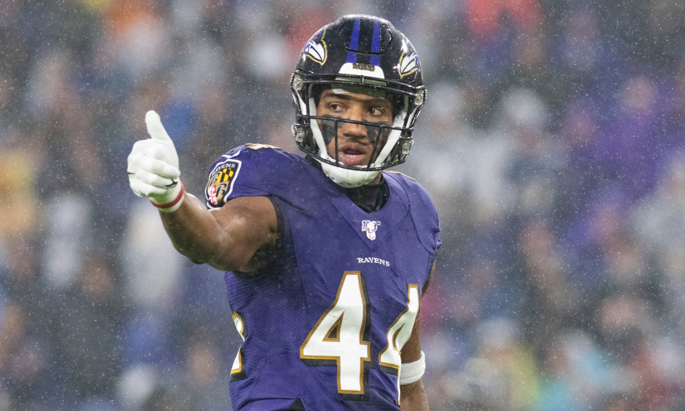Marlon Humphrey gives a thumbs up sign before the play