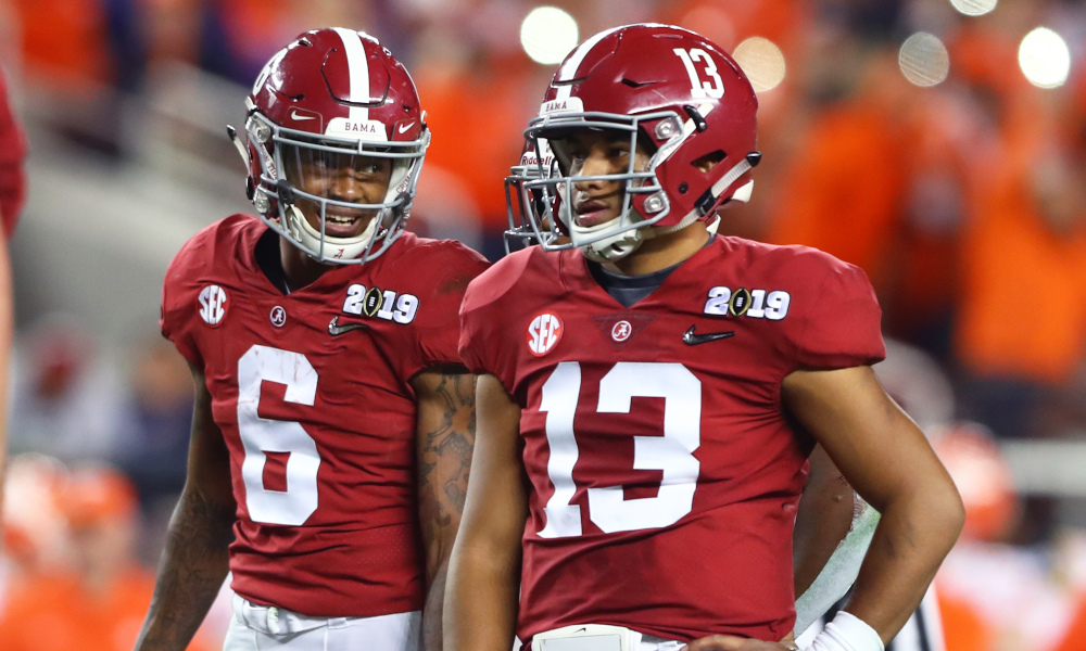 Tua Tagovailoa and Devonta Smith stand beside each other during 2019 CFP title game vs. Clemson