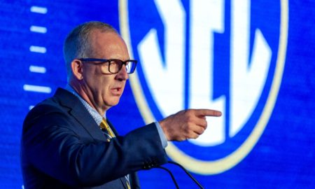 Greg Sankey answers a question at SEC Media Days