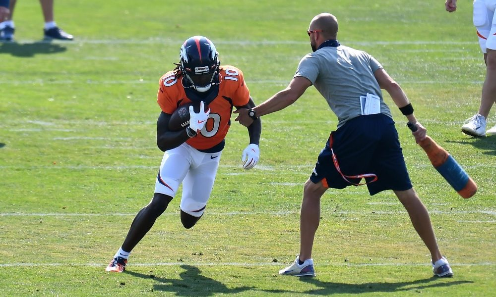 Jerry Jeudy turns up field during a drill at Broncos training camp