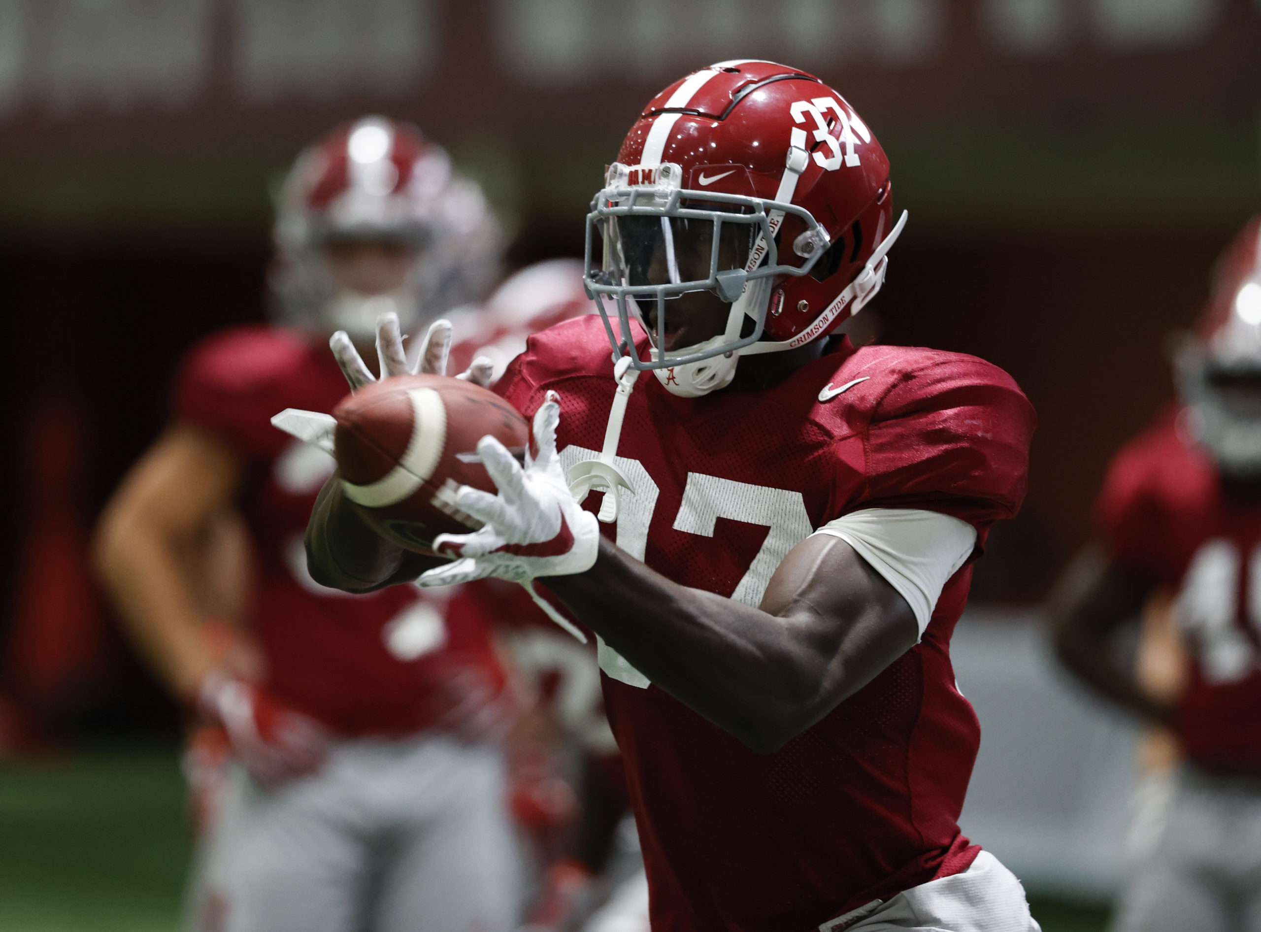 Demouy Kennedy catches football at Alabama practice
