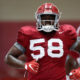 Christian Barmore running through drills at Alabama fall practice