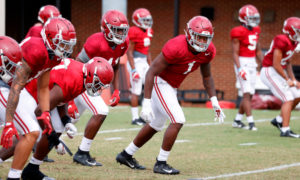 Ben Davis running drills with outside linebackers at Alabama practice