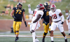 Christian Harris (No. 8) of Alabama celebrates defensive play for Alabama versus Missouri