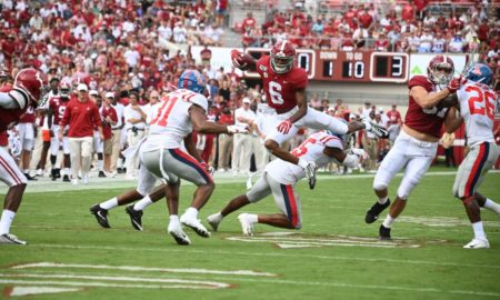 DeVonta Smith hurdles an Ole Miss defender
