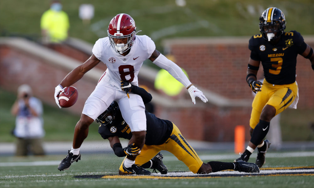 John Metchie (No. 8) of Alabama with a catch versus Missouri