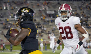 Josh Jobe (No. 28) of Alabama chasing Tyler Badie of Missouri as he scores a touchdown