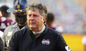 Mike Leach walking off the field after defeating LSU