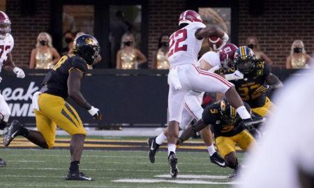 Najee Harris hurdles a Missouri defender