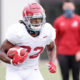 Najee Harris runs with the ball at Alabama fall practice