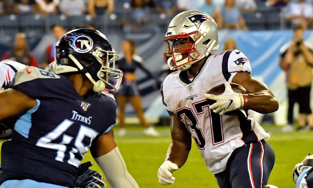 Damien Harris takes a carry against the Titans