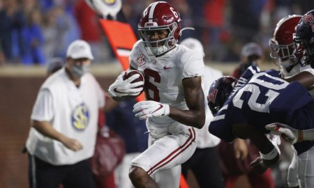 Alabama wr devonta smith carries the football against Ole Miss
