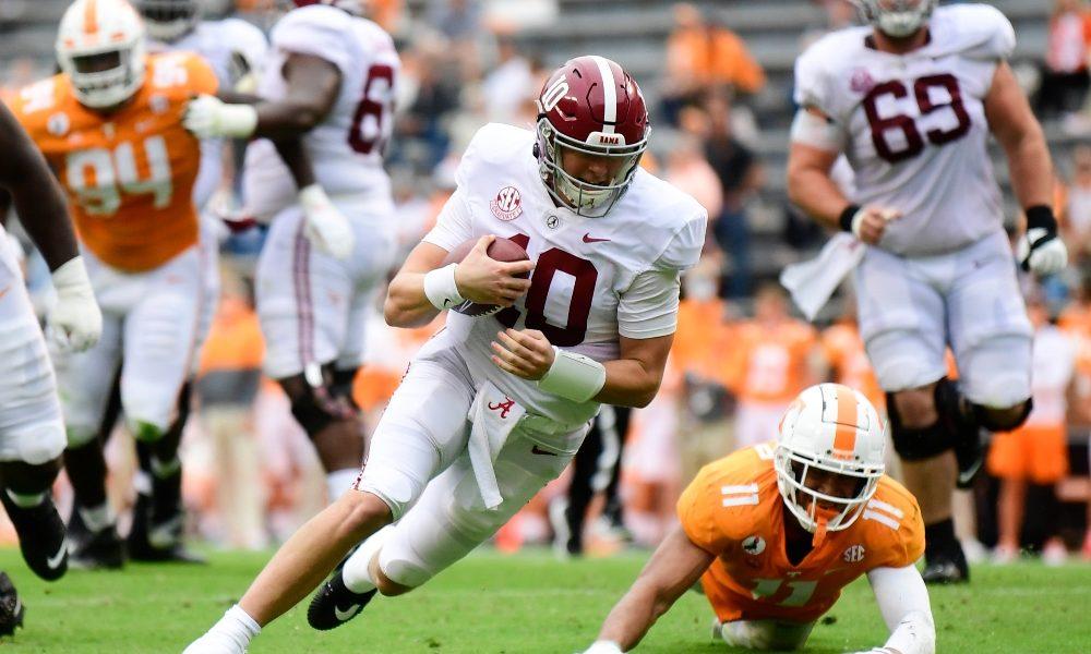 Mac Jones scrambles against Tennessee
