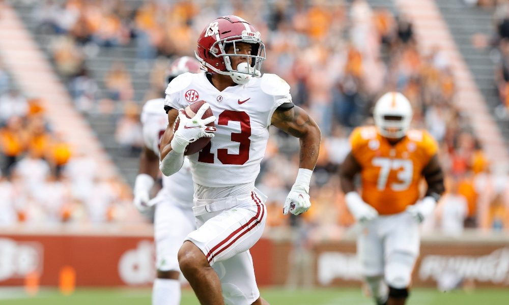 Malachi Moore returns a fumble for a touchdown against Tennessee