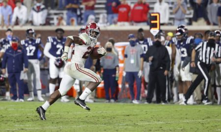 Alabama running back najee harris runs free in the open field against the Ole Miss Rebels
