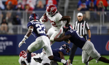 Najee Harris breaks a tackle on a run versus Mississippi