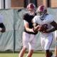 Najee Harris runs the ball in practice for Alabama
