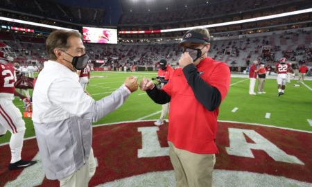 Nick Saban gets a fist bump from Kirby Smart