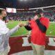 Nick Saban gets a fist bump from Kirby Smart