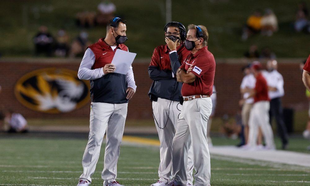 Nick Saban Steve Sarkisian and Jeff Banks talk during a timeout
