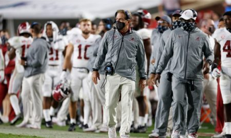 Nick Saban watches a play from the sidelines