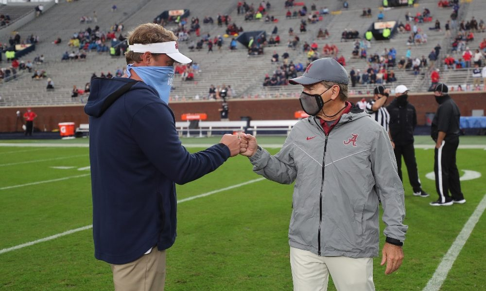 Nick Saban and Lane Kiffin fist bump ahead of their game