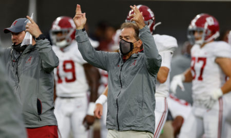 Nick Saban giving signals on the sideline versus Ole Miss