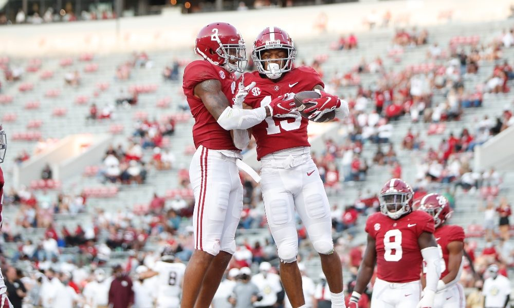 Patrick Surtain and Malachi Moore celebrate after an interception
