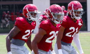 Ronald Williams Jr. (No. 22) at fall camp with Josh Jobe and Jahquez Robinson