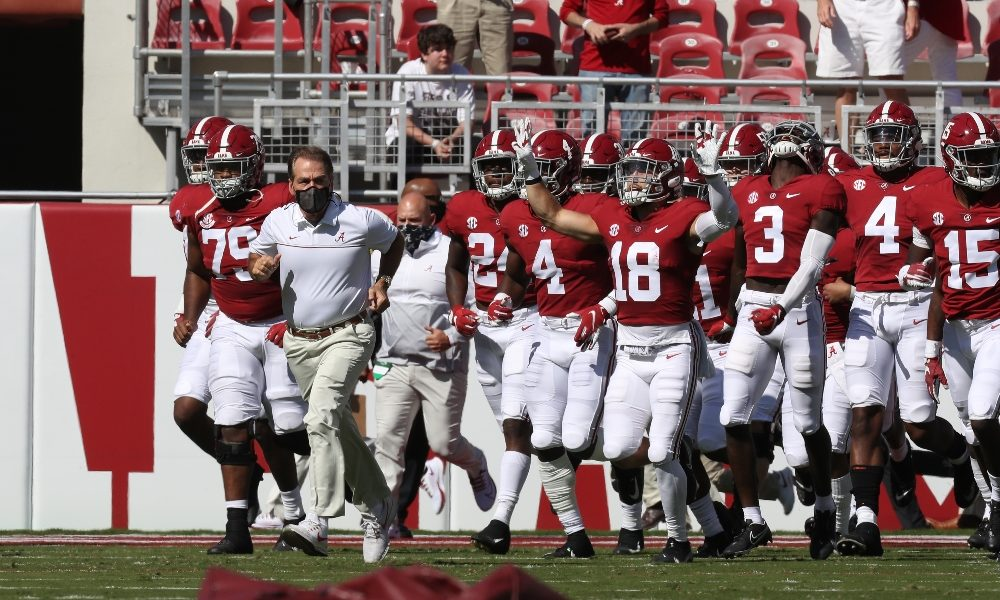 Nick Saban leads Alabama out of the tunnel against Texas A&M