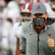 Nick Saban runs on the field for Alabama to face Ole Miss