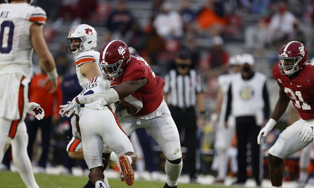 Phidarian Mathis (No. 48) makes a tackle in 2020 Iron Bowl versus Auburn