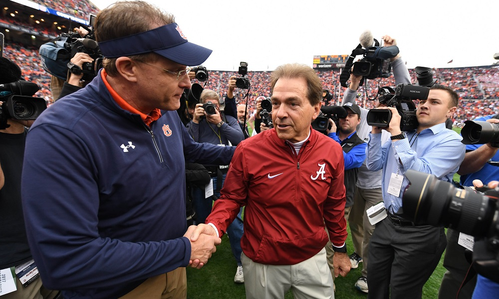 Alabama head coach nick sbana shakes hand with Auburn Hc Gus Malzahn