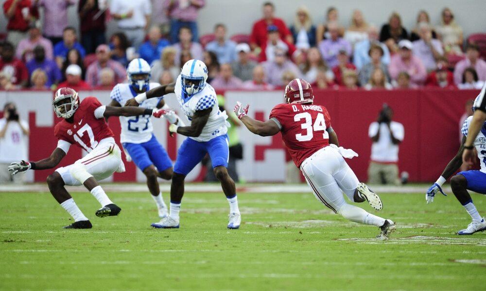 Damien Harris rushes the football against Kentucky
