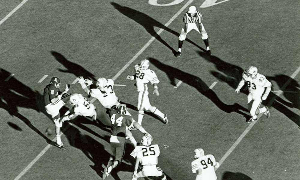 David Langner (No. 28) of Auburn returns two blocked Alabama punts for touchdowns in 1972 Iron Bowl