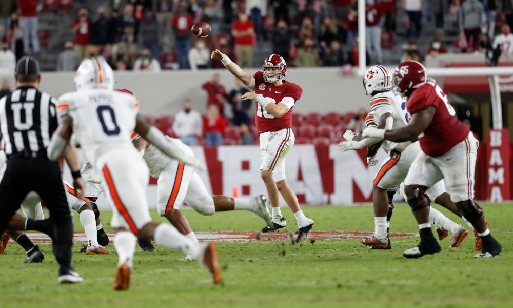 Mac Jones throws a pass versus Auburn in 2020 Iron Bowl