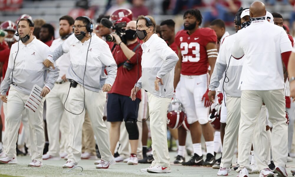 Nick Saban watches a play from the sidelines against Kentucky