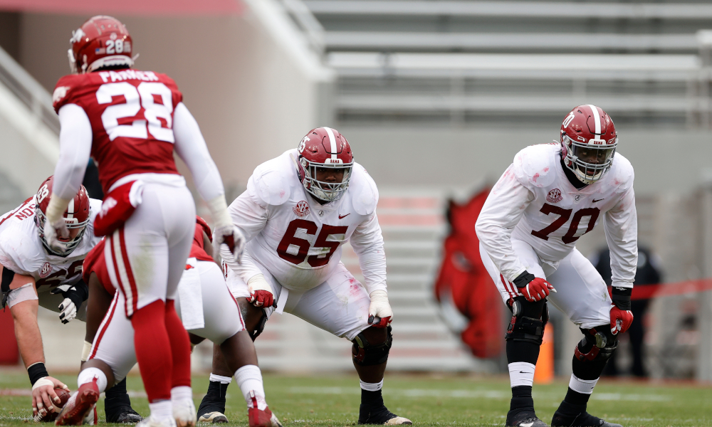 Deonte Brown (No. 65) and Alex Leatherwood (No. 70) of Alabama in their stance versus Arkansas