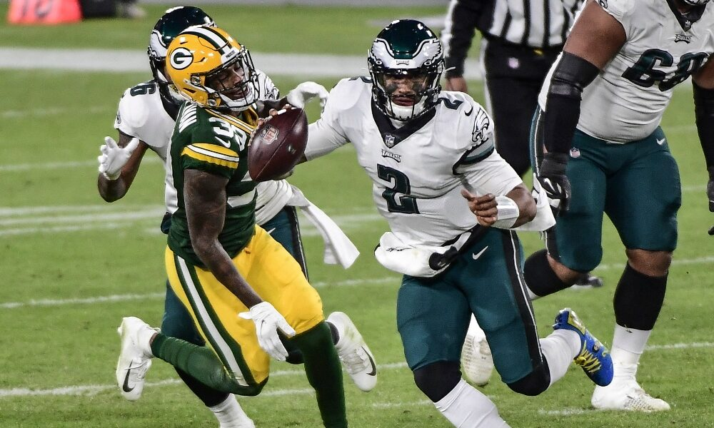 Jalen Hurts evades the rush against the Packers