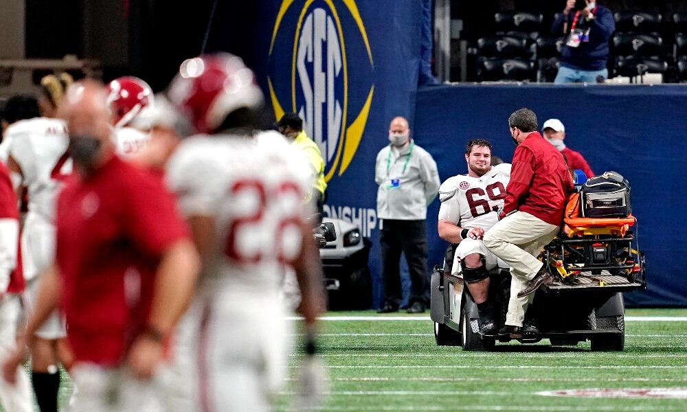 Landon Dickerson is carted off the field against Florida