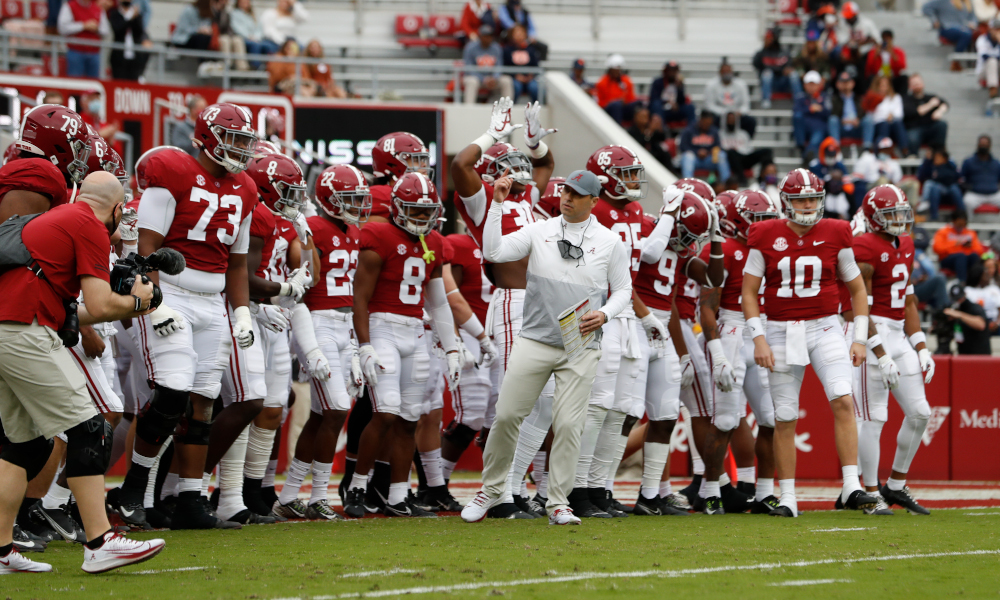 Steve Sarkisian leads Alabama onto the field for Iron Bowl game