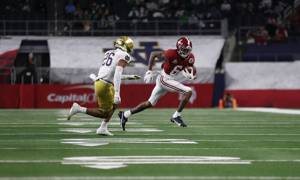 Alabama wide receiver DeVonta Smith runs with the football against Notre Dame in the Rose Bowl