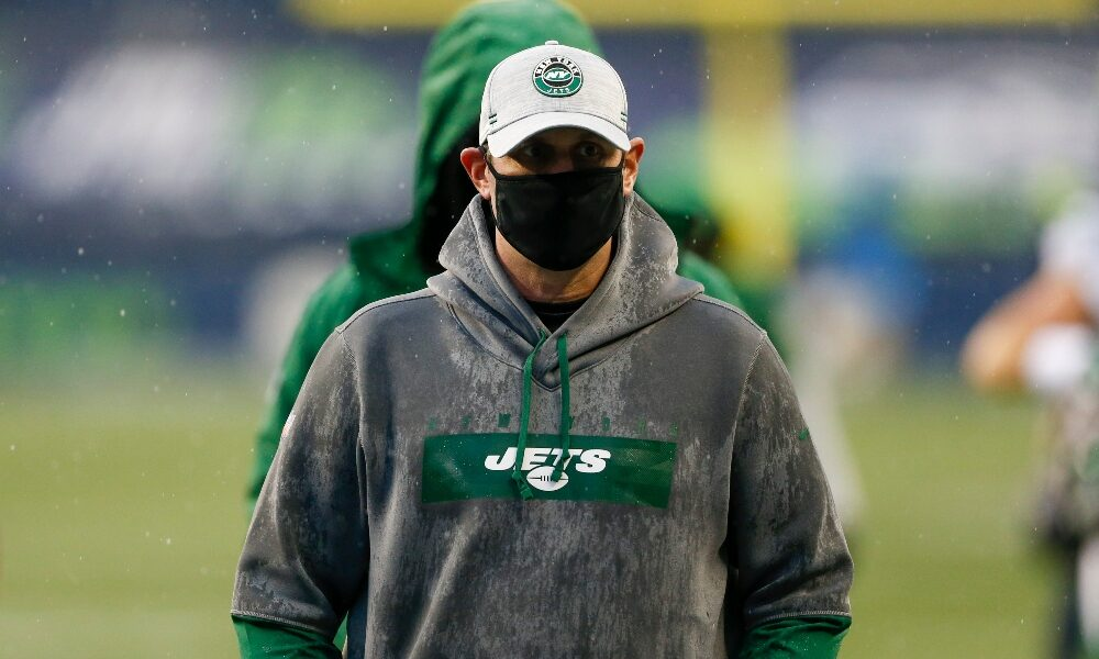 Adam Gase walking on the field